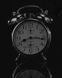 clock on black | by The Cassandra Project