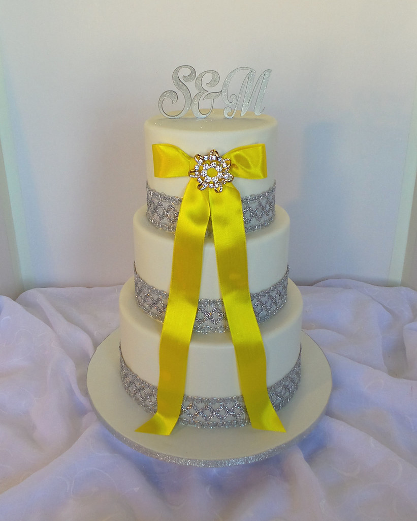 Three tier white wedding cake with silver ribbons, yellow … | Flickr