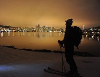 On record snow, night skier with pack and head light, city reflected in Lake Union, Space Needle, from the top of the hill, Gas Works Park, Wallingford, Seattle, Washington, USA | by Wonderlane