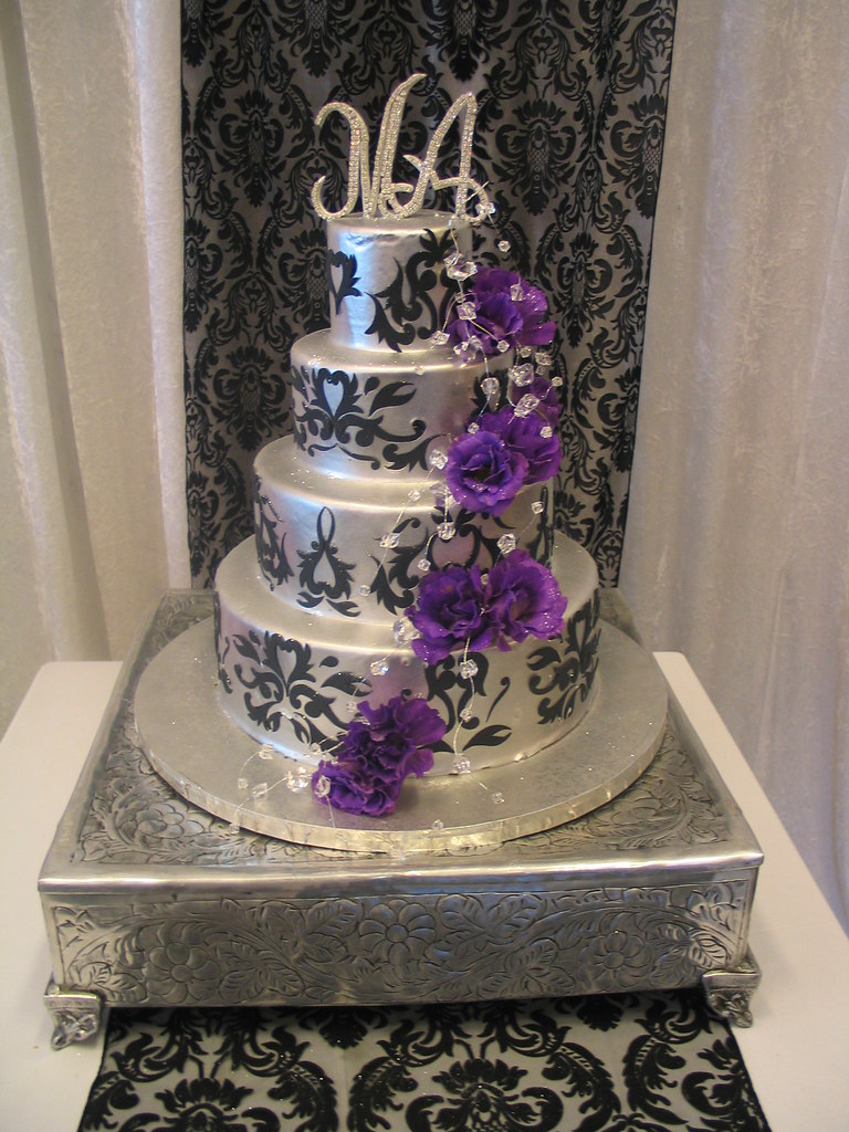 4-tier Wicked Chocolate wedding cake iced in silver chocol… | Flickr