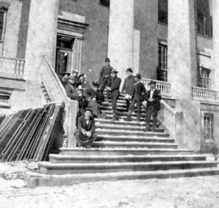 Men and women resting on the snow-covered steps of the Capitol: Tallahassee, Florida | by State Library and Archives of Florida