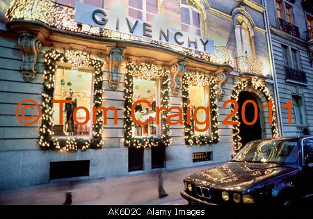 christmas decorations on givenchy luxury clothing store corporate headquarters store front paris france christmas lighting