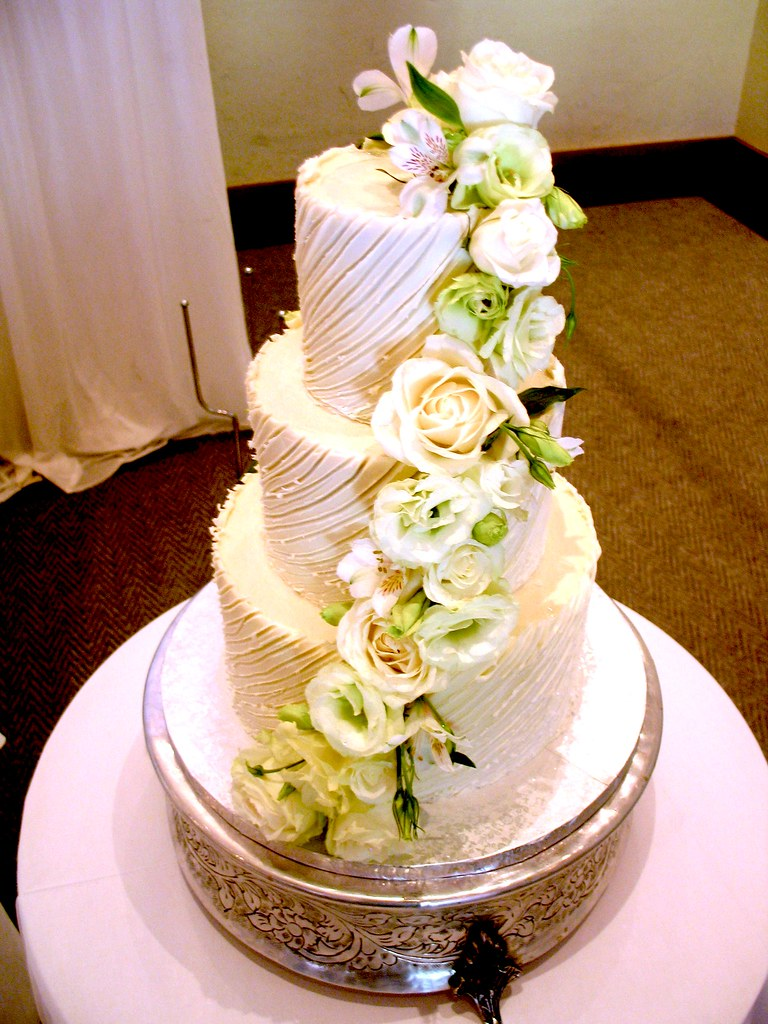 3-tier Wicked Chocolate wedding cake iced in white Spanish… | Flickr