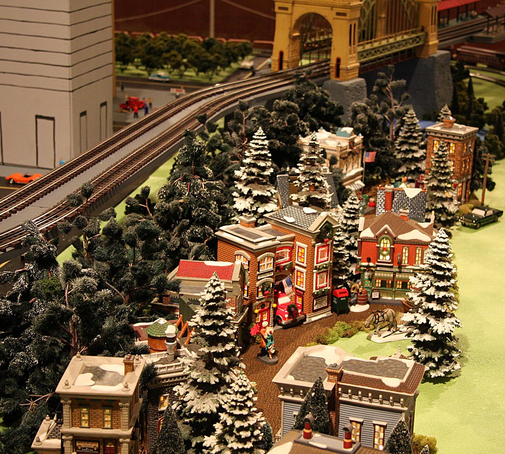 miniature electric train exhibits a miniature christmas village and train tracks by the arch bridge miniature electric train exhibits - Miniature Christmas Village