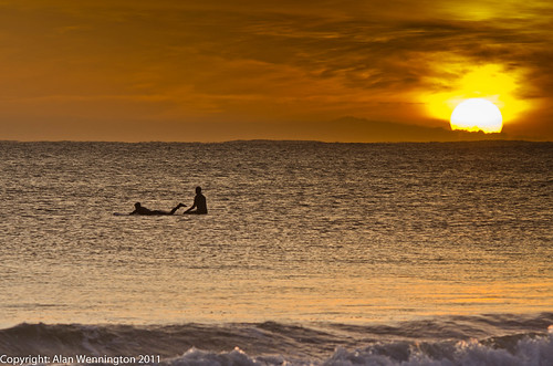 Surfers at sunrise | by Alan Wennington