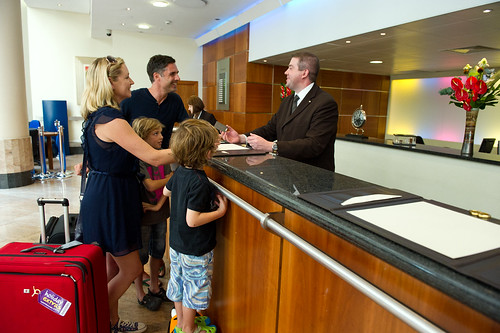 Family at the hotel check in | by Holidayextras