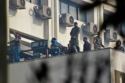 Army Soldier with a dirty gesture on top the Parliament building | by Mostafa Sheshtawy