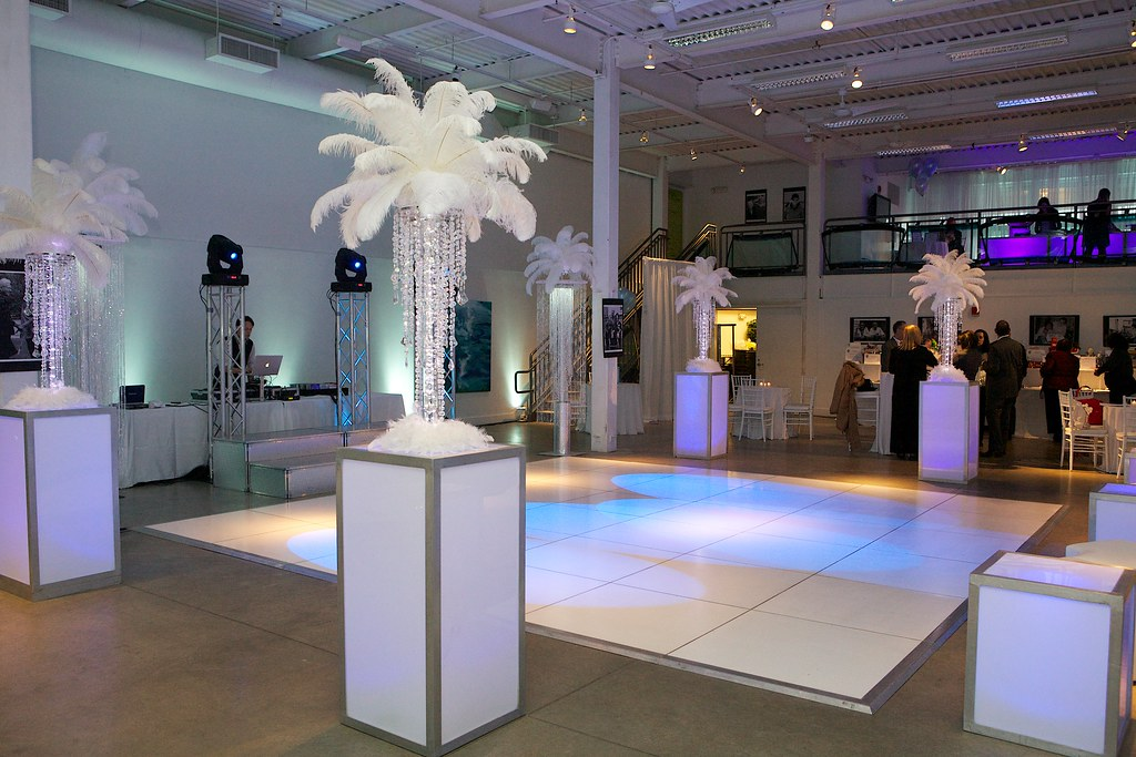 Light up chandelier centerpieces with white feather topper flickr light up chandelier centerpieces with white feather toppers for little brothers friends of the aloadofball Gallery