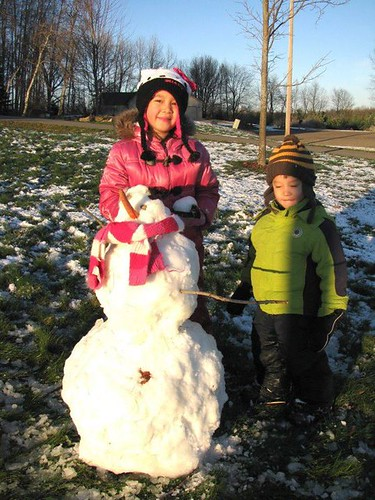 First snow and snowman in Mt. Pleasant with Aiden and Asia | by Pure Michigan