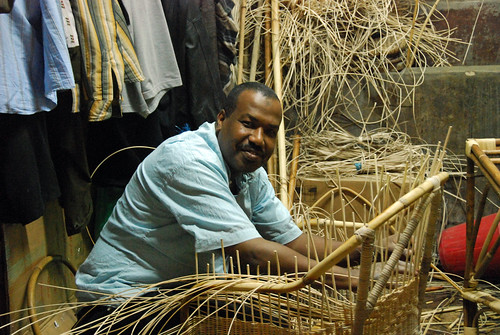 A craftsman make a chair from wicker | by World Bank Photo Collection