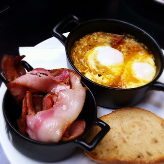 Baked eggs with a side of bacon | by ultrakml