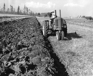 Tractor plowing fields | by OSU Special Collections & Archives : Commons