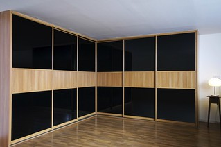 fitted-sliding-wardrobe-black-glass-mans-bedroom-corner | by Sliderobes