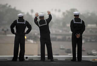 A Sailor wave goodbye to loved ones. | by Official U.S. Navy Imagery