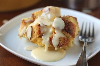 Almond Bread Pudding with Eggnog Sauce | by Completely Delicious