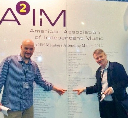 A2IM's Jim Mahoney with Midem VP North America JP Bommel celebrating A2IM's record turnout at Midem 2012. | by A2IM - American Association of Independent Music