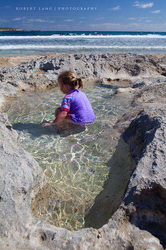 Child swimming in rock pool, Australia | by Robert Lang Photography