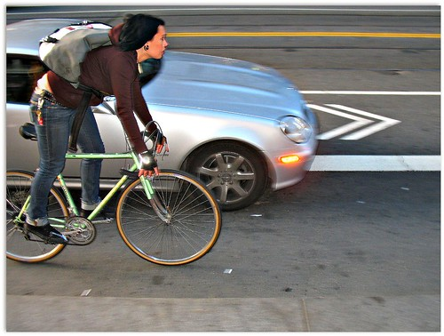 Market Street cyclist getting the squeeze | by Richard Masoner / Cyclelicious