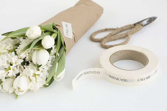 Wrapped white flowers in brown paper packaging wedding sty flickr wrapped white flowers in brown paper packaging by hearthandmadeuk mightylinksfo