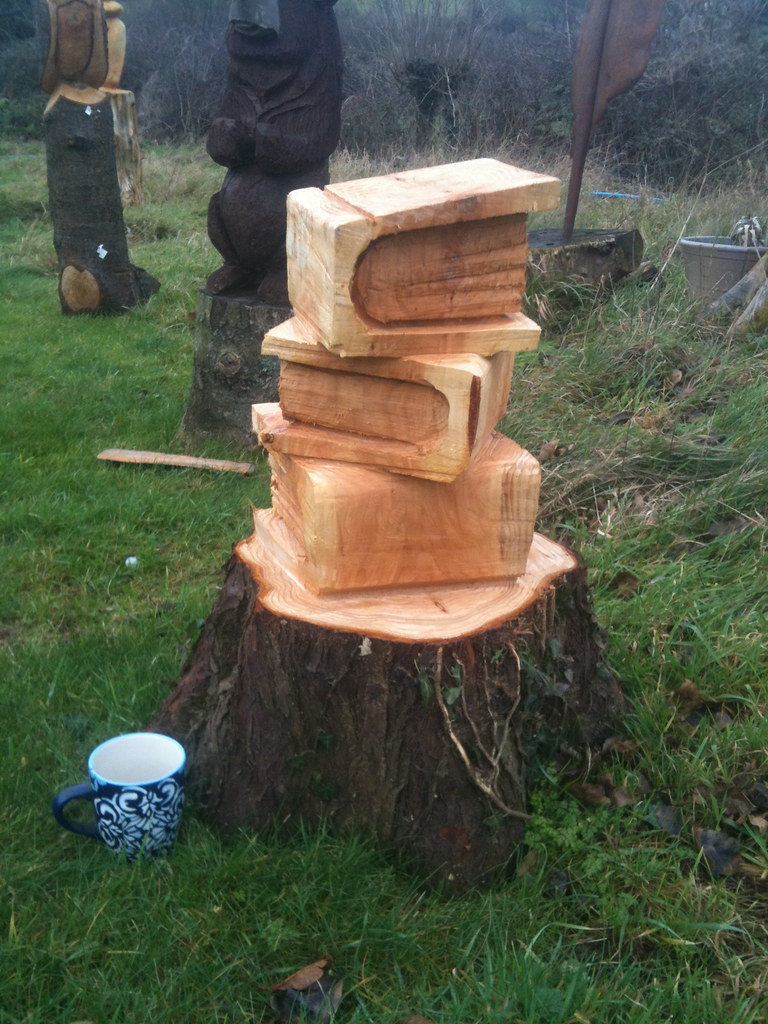 Chainsaw carved owls on books wood carvings