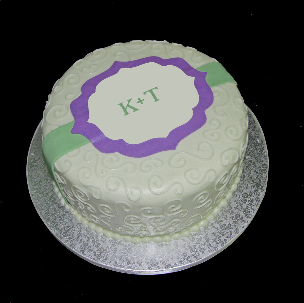 cream and purple bridal shower cake by sweet shoppe mom and simply sweets
