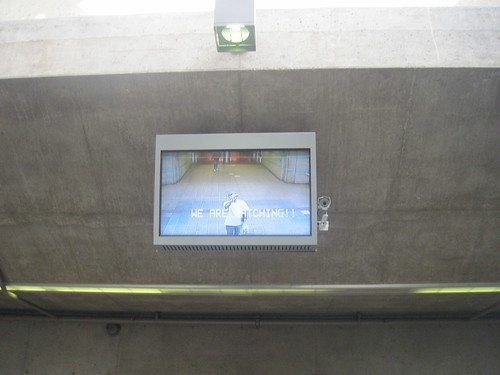 """We are watching!!"" monitor at the Red Line entrance at Union Station, Los Angeles, March 10 
