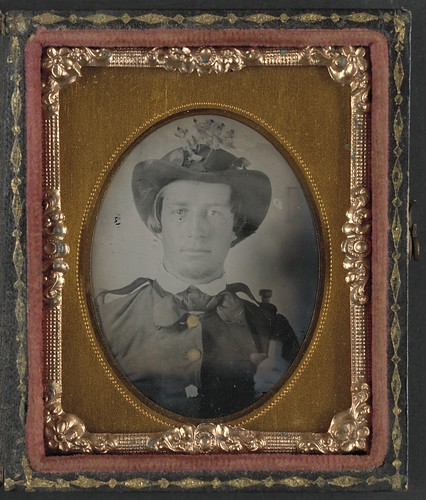 [Private Thomas Bobo of H Company, 5th South Carolina Infantry Regiment; H Company, 9th South Carolina Infantry Regiment;  K Company,1st South Carolina Light Artillery Regiment in uniform and hat decorated with flowers] (LOC) | by The Library of Congress