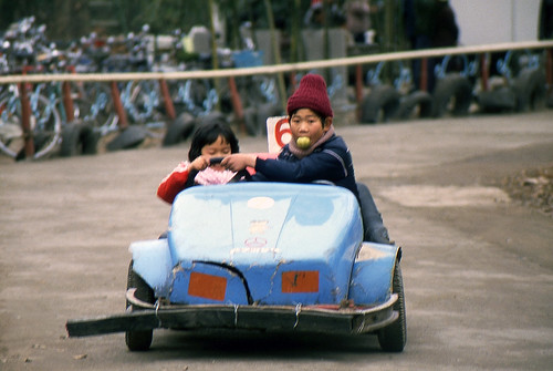Big brother interfering with his sister driving a go cart | by Just some dust