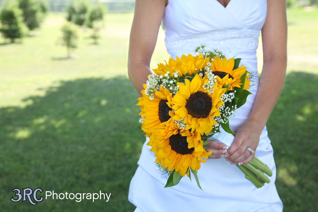 Sunflower wedding bouquet rebecca lancour flickr sunflower wedding bouquet by westosha floral junglespirit Images