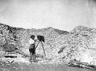 Photographer beside mounds of oyster shells: Apalachicola, Florida | by State Library and Archives of Florida