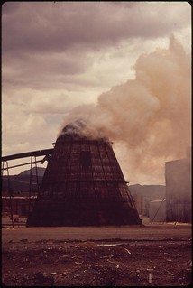 """Teepee"" burner incinerates woodchips and sawdust from the lumbermill, 05/1972. 