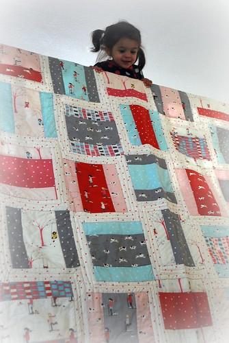 Naomi admiring her Sherbet Pips quilt