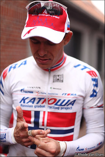 Alexander Kristoff pulling tape off  his fingers | by Rhode Van Elsen - cycling photography