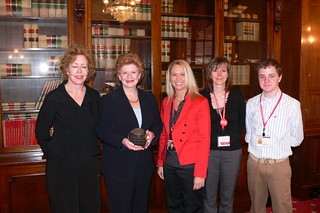 Receiving an award from Parent Project for Muscular Dystrophy | by Senator Stabenow