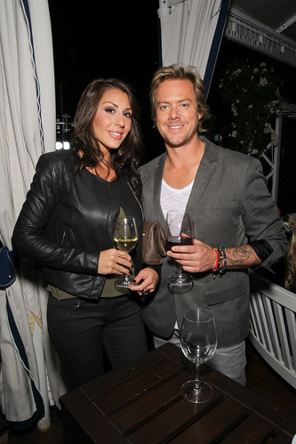 Scott Underwood, the drummer for Train, with guest at Jordan Vineyard & Winery's 40th Anniversary, held on The London Hotel rooftop in West Hollywood, California, USA on Monday, April 23, 2012 | by jordanwinery.com
