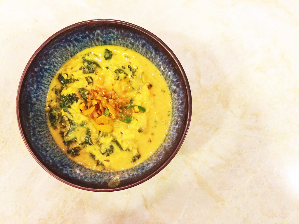 Yellow lentil dal with coconut milk and kale