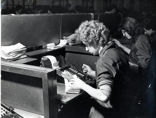 Clearing Department, woman sorting cheques and using adding machine - 1960s | by HSBC UK Press Office