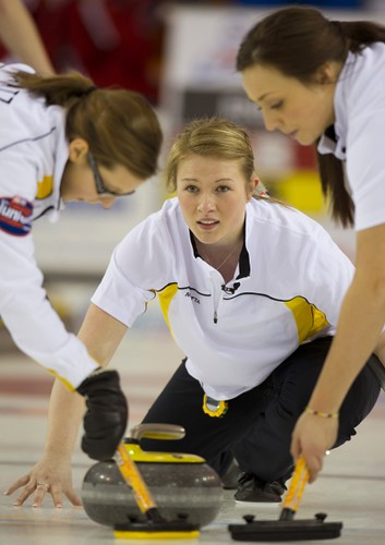 Napanee, ON Feb 11 2011 M&M Canadian Juniors Team Manitoba Second Kristin MacCuish with sweepers thrid Selena Kaatz and Lead Mariah Mondor. Michael Burns Photo Ltd. | by seasonofchampions