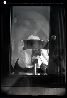 reflected self-portrait with Baldi camera and beekeeping hat and veil | by pho-Tony