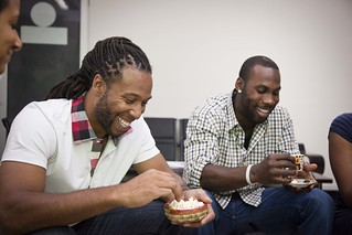 Larry Fitzgerald and Anquan Boldin getting a taste of the local food and drink in Ethiopia | by Oxfam America
