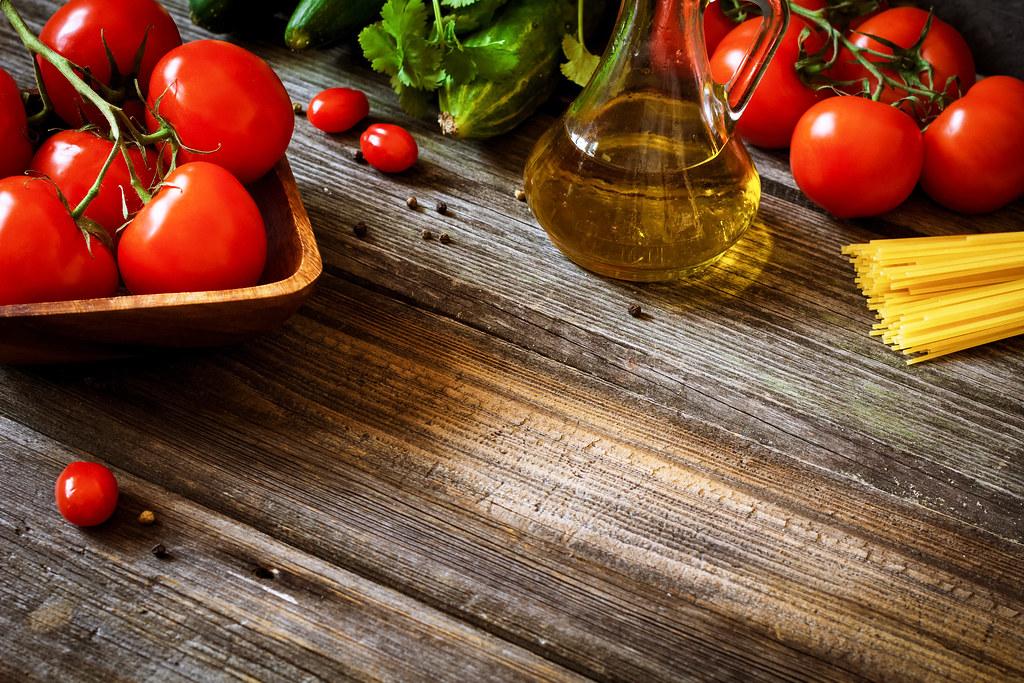 Italian Food Ingredients On Rustic Wooden Backdrop