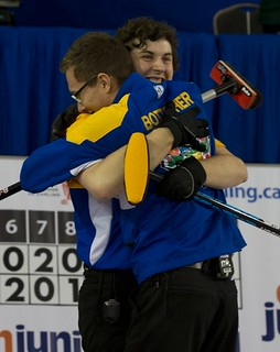 Napanee, ON Feb 12 2011 M&M Canadian Juniors Team Alberta Skip Brendan Bottcher & Thrid Landon Bucholz embrace after winning the CCA Napanee Jr's 9-7. Michael Burns Photo Ltd. | by seasonofchampions