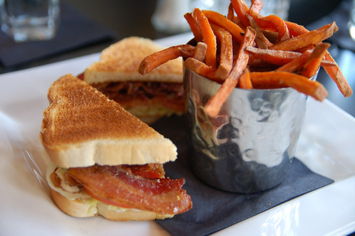 The BLT and yam fries at Avalon make a fine cushion for a cocktail | by Dana McMahan
