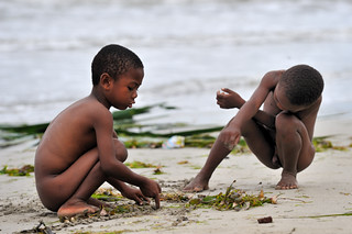 kids playing with the sand on the beach   madagascar nossi