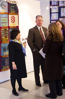 Dick and Allison Wilbur, in front of the Srebrenica Diaspora Quilt | by The Advocacy Project