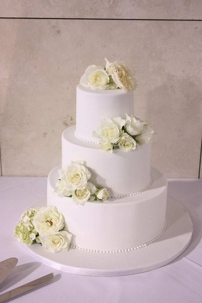 Classic white wedding cake with fresh florals   Delivered to…   Flickr