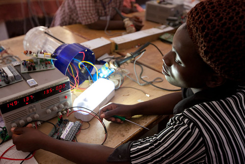 Gertrude from Malawi tests one of her solar lights | by UN Women Gallery