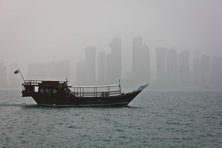 Dhow boat and the Doha city covered in the mist. | by Faisal I am