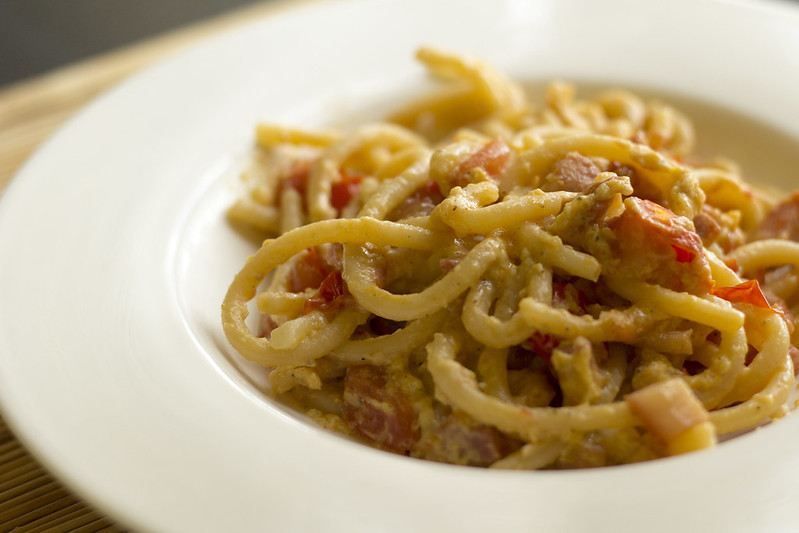 Pici carbonara with cherry tomatoes