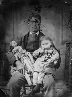 A man holding a child and a doll | by LlGC ~ NLW